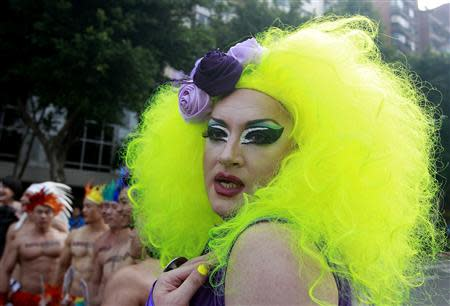 A man dressed in drag parades during the Taiwan LGBT Pride Parade in Taipei October 26, 2013. REUTERS/Pichi Chuang