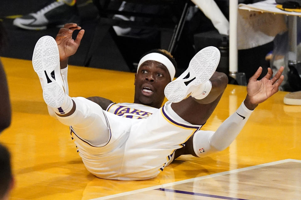 Los Angeles Lakers guard Dennis Schroder falls after being fouled in the act of shooting during the first half of an NBA basketball game against the Golden State Warriors Sunday, Feb. 28, 2021, in Los Angeles. (AP Photo/Mark J. Terrill)
