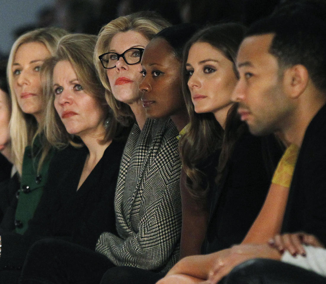 Actress Christine Baranski (3rd L) and singer John Legend (R) watch the Vera Wang Autumn/Winter 2013 collection during New York Fashion Week, February 12, 2013.  REUTERS/Brendan McDermid (UNITED STATES - Tags: FASHION ENTERTAINMENT) - RTR3DP9O