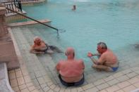 Bathers relax at the Szechenyi thermal bath as the coronavirus disease (COVID-19) restrictions are eased in Budapest