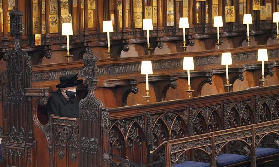 The Queen sits alone in St George's chapel
