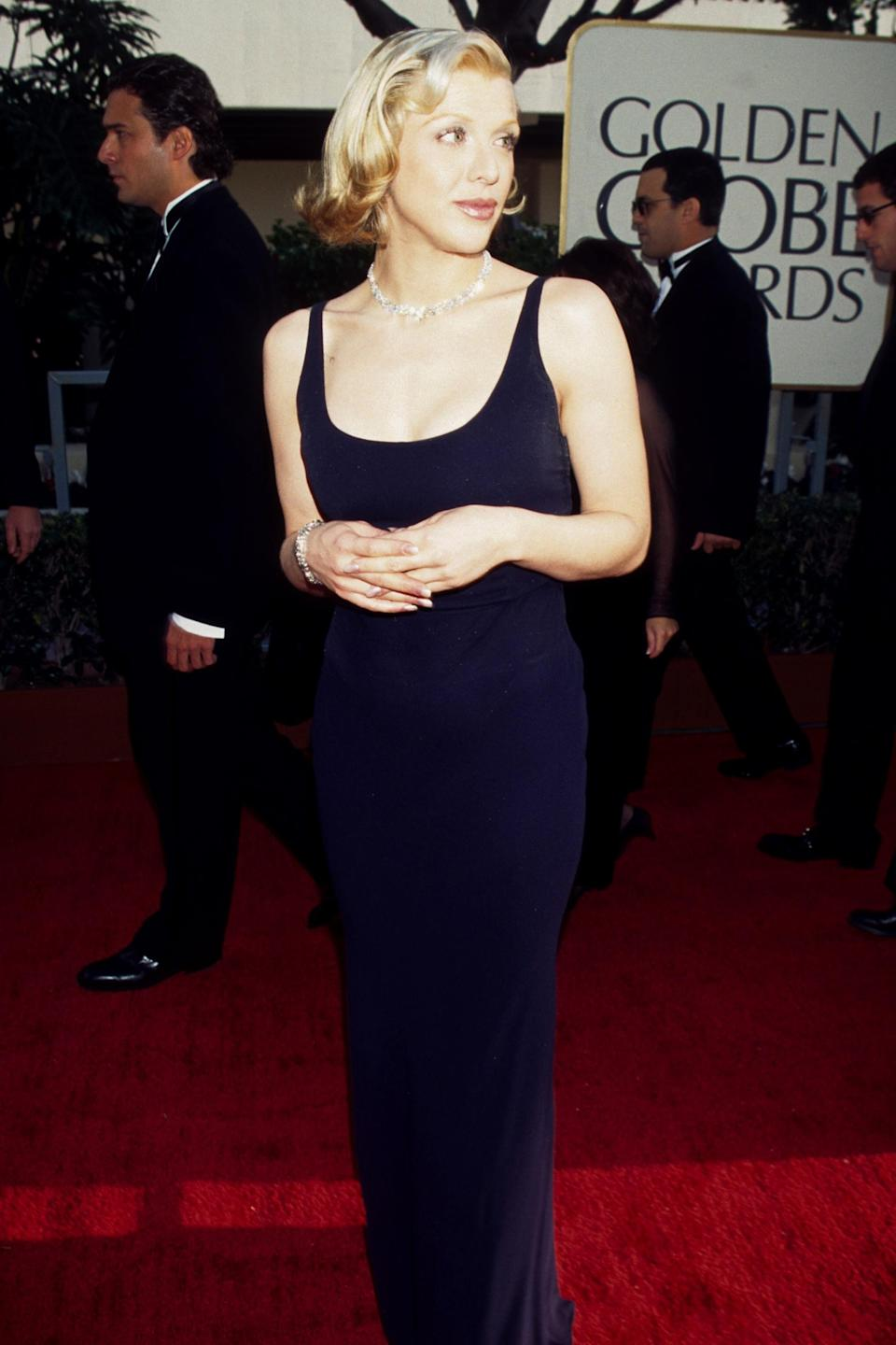 """<strong><h2>1997</h2></strong><br>Courtney Love has had her fair share of fashion faux pas moments. But after seeing her in this navy blue garb, we're reminded that this grunge goddess often cleans up <em>real good. </em><br><br><em>Courtney Love in a navy blue dress. </em><span class=""""copyright"""">Photo: Ke.Mazur/WireImage.</span>"""