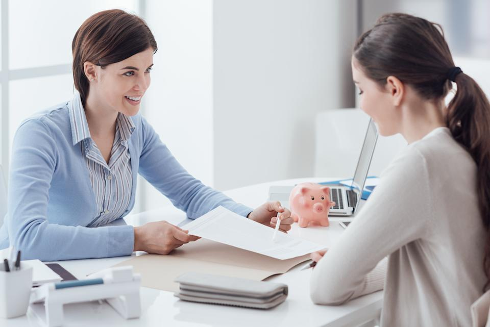 Business consultant and customer meeting in the office, the businesswoman is holding a contract and pointing