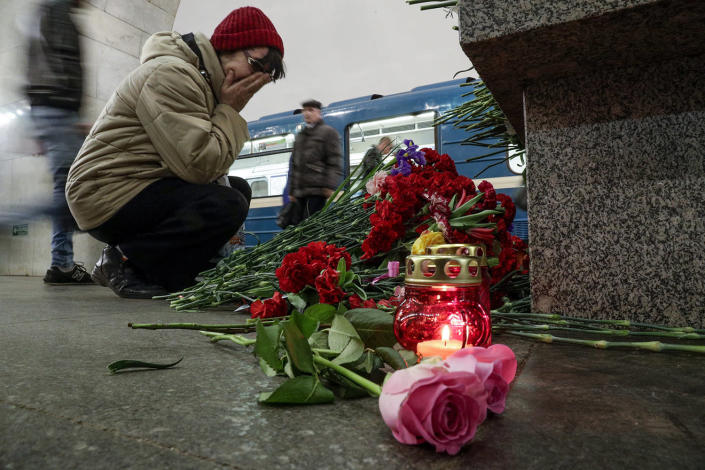 <p>A woman reacts as she lays flowers at a symbolic memorial at Tekhnologichesky Institute subway station in St. Petersburg, Russia, Tuesday, April 4, 2017. A bomb blast tore through a subway train deep under Russia's second-largest city St. Petersburg Monday, killing several people and wounding many more in a chaotic scene that left victims sprawled on a smoky platform. (Dmitri Lovetsky/AP) </p>