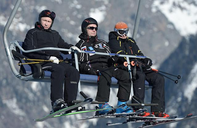 """Russian President Vladimir Putin (L) and Prime Minister Dmitry Medvedev (C) sit on a chair lift during their visit to the """"Laura"""" cross country ski and biathlon centre in the resort of Krasnaya Polyana near Sochi January 3, 2014. REUTERS/Alexei Nikolskiy/RIA Novosti/Kremlin (RUSSIA - Tags: POLITICS SPORT OLYMPICS) ATTENTION EDITORS - THIS IMAGE HAS BEEN SUPPLIED BY A THIRD PARTY. IT IS DISTRIBUTED, EXACTLY AS RECEIVED BY REUTERS, AS A SERVICE TO CLIENTS"""