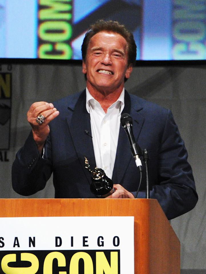 "SAN DIEGO, CA - JULY 12:  Actor Arnold Schwarzenegger speaks at ""The Expendables 2 Real American Heroes"" Panel during Comic-Con International 2012 at San Diego Convention Center on July 12, 2012 in San Diego, California.  (Photo by Kevin Winter/Getty Images)"