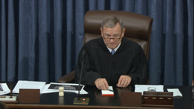 In this image from video, presiding officer Supreme Court Chief Justice John Roberts listens during the impeachment trial against President Donald Trump in the Senate at the U.S. Capitol in Washington, Thursday, Jan. 23, 2020. (Senate Television via AP)