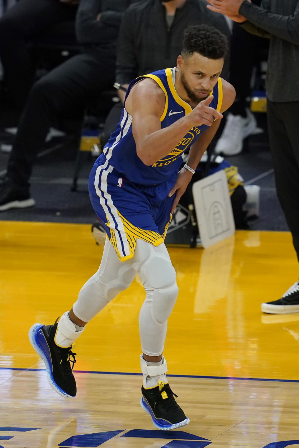 Golden State Warriors guard Stephen Curry reacts after scoring against the Cleveland Cavaliers during the second half of an NBA basketball game in San Francisco, Monday, Feb. 15, 2021. (AP Photo/Jeff Chiu)
