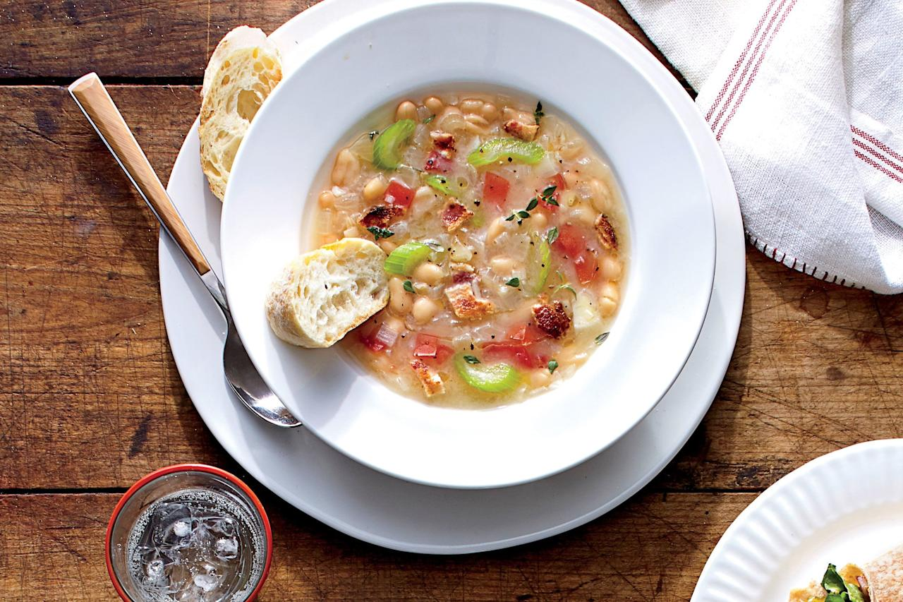 """<p>Soups are the most <a href=""""https://www.southernliving.com/dish/soup/best-fall-soups"""">comforting dishes for fall</a> and winter nights. But if you want to do homemade soup right, you have to spend hours letting the broth simmer or leave it in the slow cooker all day. Not anymore! You might not believe us, but this Smoky White Bean Soup is ready from start to finish in just 25 minutes. That's less time than it takes Mama to put her face on! Not only is this recipe super quick, but it cooks in one pot. A 25-minute, <a href=""""https://www.southernliving.com/food/whats-for-supper/easy-one-dish-dinner-recipes"""">one-dish recipe</a> that's comforting and filling is a winner in every sense of the word. This recipe starts with one of our favorite things—bacon—but only one thick-cut slice of bacon, so make it an extra thick slice. This recipe is so easy because that you're not chopping your time away. Pre-chopped onion, pre-chopped celery, one minced garlic clove, and a teaspoon of chopped fresh thyme are next in the pan, and they cook right in the bacon drippings. Talk about yum. Add chicken broth, cannellini beans, one chopped and seeded plum tomato, one bay leaf, salt, and pepper, and you're done. Really, we wouldn't lie! This soup only simmers for eight minutes after it's brought to a boil, and it's ready to eat. This recipe is so easy to whip up the fastest lunch or dinner ever, and you can make it ahead to take to work for the most comforting brown-bag lunch in the office.</p> <p><a href=""""https://www.myrecipes.com/recipe/smoky-white-bean-soup"""">Smoky White Bean Soup Recipe</a></p>"""
