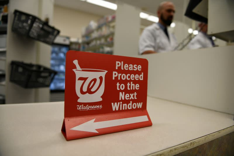 A pharmacist works at a Walgreens pharmacy store in Austin, Texas