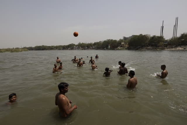 ndian youth cool off in the River Yamuna in New Delhi, India (Manish Swarup/AP)