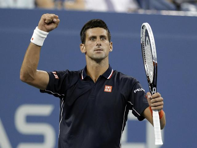 Novak Djokovic, of Serbia, reacts after winning a game against Andy Murray, of Britain, during the quarterfinals of the U.S. Open tennis tournament early Thursday, Sept. 4, 2014, in New York. (AP Photo/Darron Cummings)