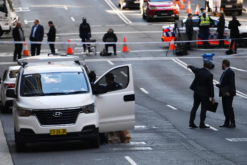 Police work at the scene of a fatal shooting on Bridge Street in the CBD, Sydney, Friday, June 18, 2021. Source: AAP