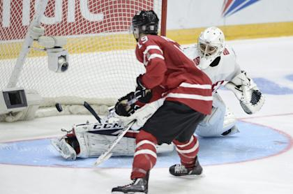 Canada's Brayden Point scores the first goal of the penalty shootout at the goal of Swiss goalie Joren von Pottelberghe during the 2016 IIHF World Junior U20 Ice Hockey Championships tournament match Switzerland vs Canada in Helsinki, Finland December 29, 2015.  REUTERS/Heikki Saukkomaa/Lehtikuva  ATTENTION EDITORS - THIS IMAGE WAS PROVIDED BY A THIRD PARTY. FOR EDITORIAL USE ONLY. NOT FOR SALE FOR MARKETING OR ADVERTISING CAMPAIGNS. THIS PICTURE IS DISTRIBUTED EXACTLY AS RECEIVED BY REUTERS, AS A SERVICE TO CLIENTS. NO THIRD PARTY SALES. NOT FOR USE BY REUTERS THIRD PARTY DISTRIBUTORS. FINLAND OUT. NO COMMERCIAL OR EDITORIAL SALES IN FINLAND.