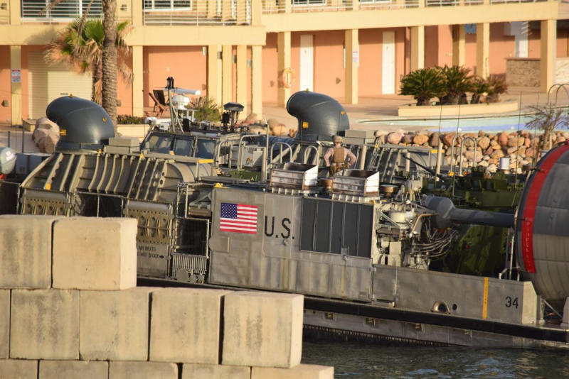 A U.S. amphibious hovercraft prepares to depart with evacuees from Janzur, west of Tripoli, Libya, Sunday, April 7, 2019. The United States says it has temporarily withdrawn some of its forces from Libya due to deteriorating security conditions. The pullout comes as a Libyan commander's forces advanced toward the capital of Tripoli and clashed with rival militias. A small contingent of American troops has been in Libya in recent years helping local forces combat Islamic State and al-Qaida militants and protecting diplomatic facilities. (AP Photo/Mohammed Omar Aburas)