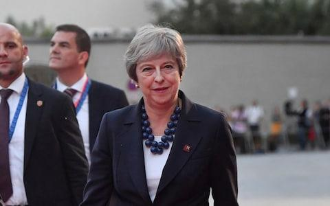 Mrs May, who is in Salzberg, accused Facebook and other social media companies of failing to tackle the problem - Credit: Kerstin Joensson/AP