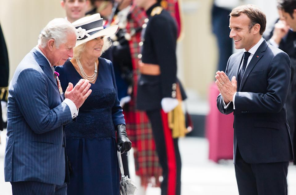 LONDON, ENGLAND - JUNE 18: Prince Charles, Prince of Wales and Camilla, Duchess of Cornwall receive French President Emmanuel Macron during a ceremony at Carlton Gardens on June 18, 2020 in London, England.  L'Appel du 18 Juin (The Appeal of 18 June) was the speech made by Charles de Gaulle to the French in 1940 and broadcast in London by the BBC. It called for the Free French Forces to fight against German occupation. The appeal is often considered to be the origin of the French Resistance in World War II. President Macron is the first foreign dignitary to visit the UK since the coronavirus lockdown began. (Photo by Samir Hussein/WireImage)