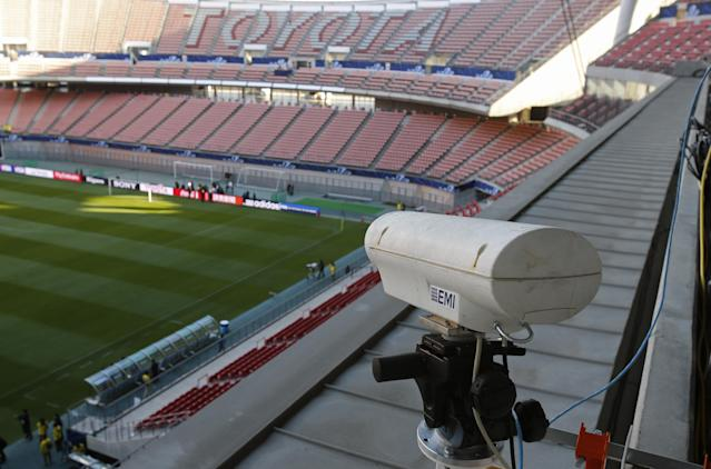 FILE - In this Saturday, Dec. 8, 2012, file photo, a Hawk-Eye camera is set up at Toyota stadium in Toyota. For the first time at a World Cup, technology will be used to determine whether a ball crosses the goal line during matches at the upcoming tournament in Brazil. With vanishing spray also being used to prevent encroachment by defenders making up a wall during free kicks, officials at the highest level of the world's most popular sport are finally getting some assistance. (AP Photo/Shuji Kajiyama)