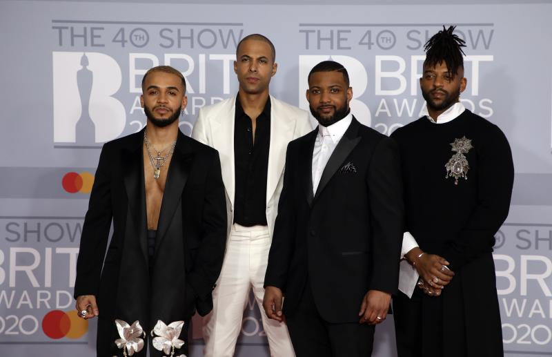 JLS pose for photographers upon arrival at Brit Awards 2020 in London, Tuesday, Feb. 18, 2020.(Photo by Vianney Le Caer/Invision/AP)