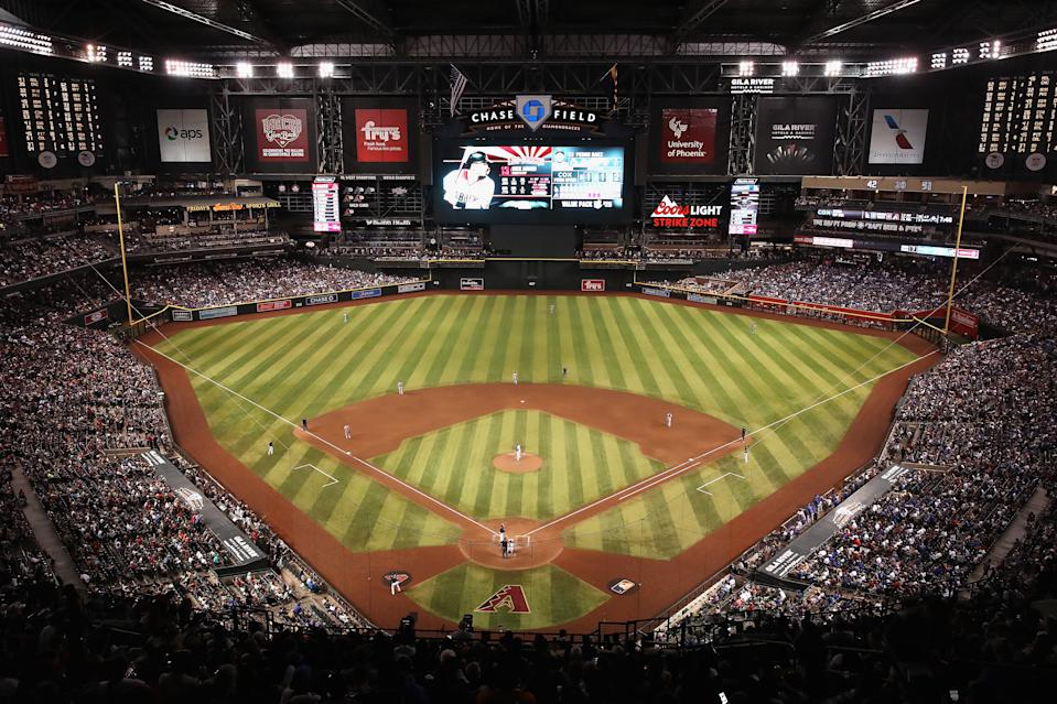 PHOENIX, ARIZONA - AUGUST 31:  General view of action as relief pitcher Pedro Baez #52 of the Los Angeles Dodgers pitches against Nick Ahmed #13 of the Arizona Diamondbacks during the seventh inning of the MLB game at Chase Field on August 31, 2019 in Phoenix, Arizona. The Diamondbacks set an attendance record with a sold-out crowd of 50,180.  (Photo by Christian Petersen/Getty Images)
