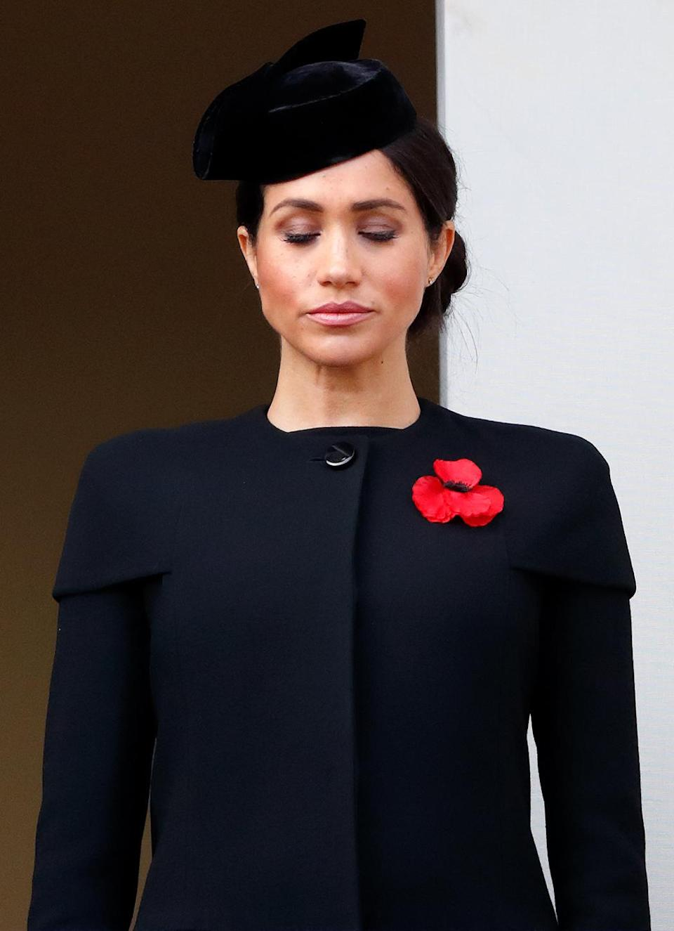 <p>Meghan stands on the balcony of the Foreign Office during the Remembrance Sunday service (Getty) </p>