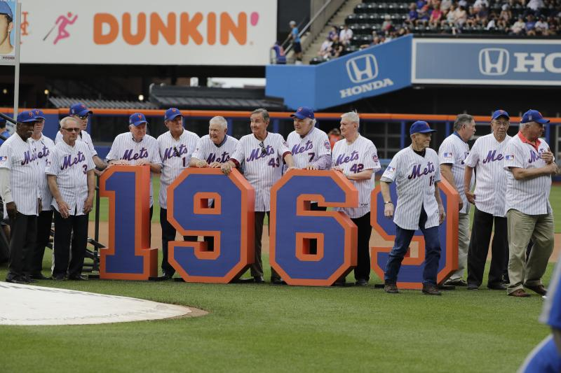 The 1969 met leave the field after a pre-game ceremony to honor them before a baseball game against the Atlanta Braves Saturday, June 29, 2019, in New York. (AP Photo / Frank Franklin II)