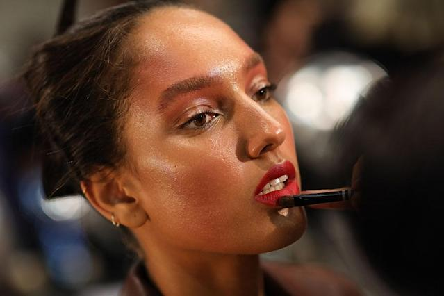 <p>Dewy skin, bare eyes, brushed-up brows, and an overall flush pair perfectly with the vermilion red lip at Bibhu Mohapatra. (Photo: Getty Images) </p>