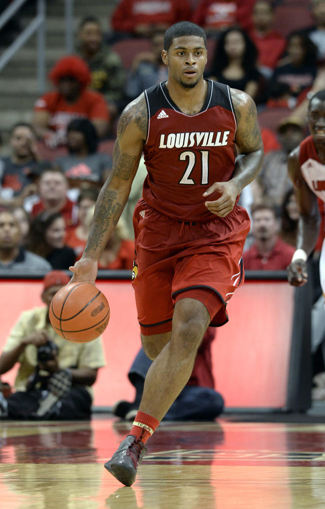 Louisville's Chane Behanan brings the ball upcourt during action of their NCAA mens college basketball scrimmage Saturday, Oct. 5, 2013, in Louisville, Ky. (AP Photo/Timothy D. Easley)