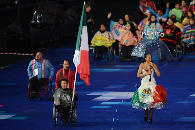 LONDON, ENGLAND - AUGUST 29: Swimmer Patricia Valle of Mexico carries the flag during the Opening Ceremony of the London 2012 Paralympics at the Olympic Stadium on August 29, 2012 in London, England. (Photo by Gareth Copley/Getty Images)