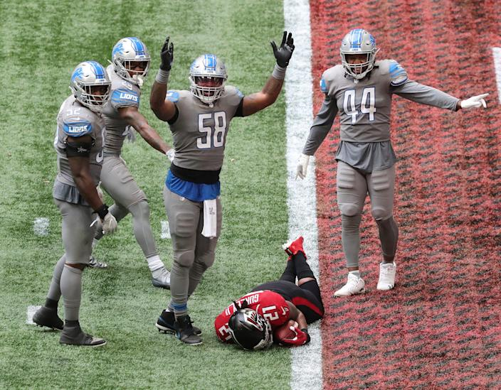 """Lions linebacker Jamie Collins signals """"touchdown"""" as Falcons running back Todd Gurley tries to stop short of the end zone to control the final minutes of the clock in the fourth quarter of the Lions' 23-22 win on Sunday, Oct. 25, 2020, in Atlanta."""
