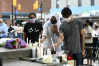 <p>People place candles at a memorial for the four family members who were killed in a vehicle attack that police say was motivated by anti-Muslim hate, in London, Ont., in Ottawa, on Tuesday, June 8, 2021. THE CANADIAN PRESS/Justin Tang</p>