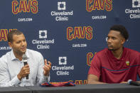 Cleveland Cavaliers first-round draft selection, Evan Mobley, right, listens to Cavaliers GM Koby Altman during a news conference at the NBA basketball team's training facility in Independence, Ohio, Friday, July 30, 2021. (AP Photo/Phil Long)