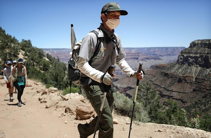 A park ranger wears a face mask while patrolling a trail in Grand Canyon National Park in Arizona on May 25.