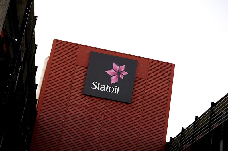 """FILE- The head office of Statoil in Stavanger, Norway, in this file photo dated Jan. 18, 2013.  The headquarters of Statoil in Stavanger were raided by anti-trust authorities on Tuesday May 14, 2013, investigating alleged price-fixing by oil companies including BP, Shell and Statoil.  A Commission launched by European anti-trust authorities to investigate concerns that oil companies """"may have colluded in reporting distorted prices"""",  the commission said in a statement after unannounced inspections on Tuesday. (AP Photo / Kent Skibstad, NTB scanpix, File) NORWAY OUT"""