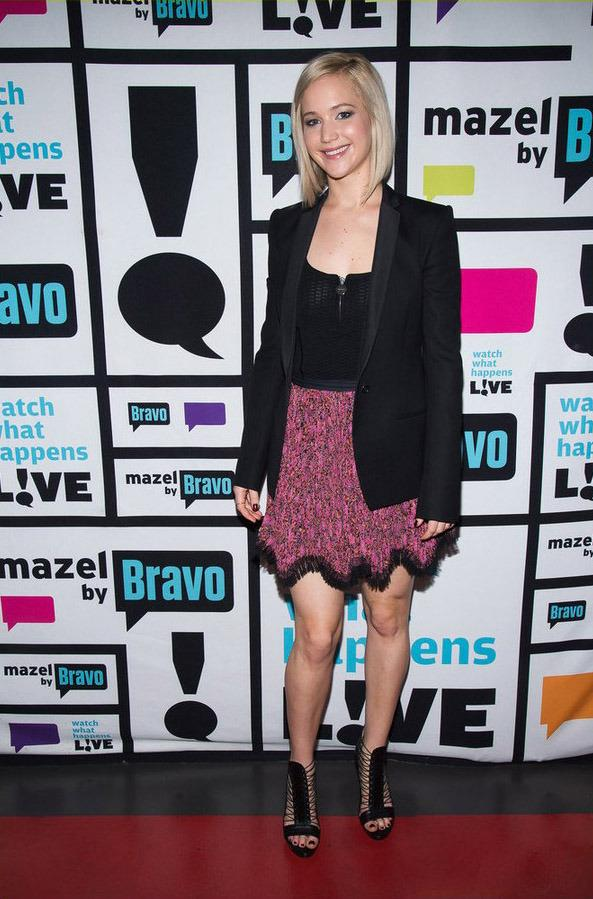 """<p>For her first appearance on <i>Watch What Happens Live!</i><i>, </i>Lawrence looked business-chic in a knee-length floral skirt lined with fringe, black blazer and lace-up heels. And while the 25-year-old's outfit was on point (especially for the holidays!), her answers to the questions host Andy Cohen posed were even better—like admitting to hooking up with Liam Hemsworth! Though when asked about a potential Justin Bieber fling, she replied: """"I'm going to say a hard no."""" Too bad! (Photo: NBC)</p>"""