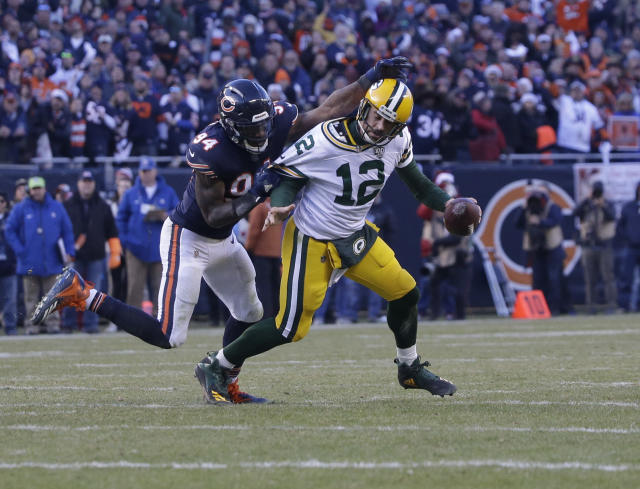 Green Bay Packers quarterback Aaron Rodgers (12) is sacked by Chicago Bears outside linebacker Leonard Floyd (94) during the second half of an NFL football game Sunday, Dec. 16, 2018, in Chicago. The Bears won 24-17. (AP Photo/David Banks)