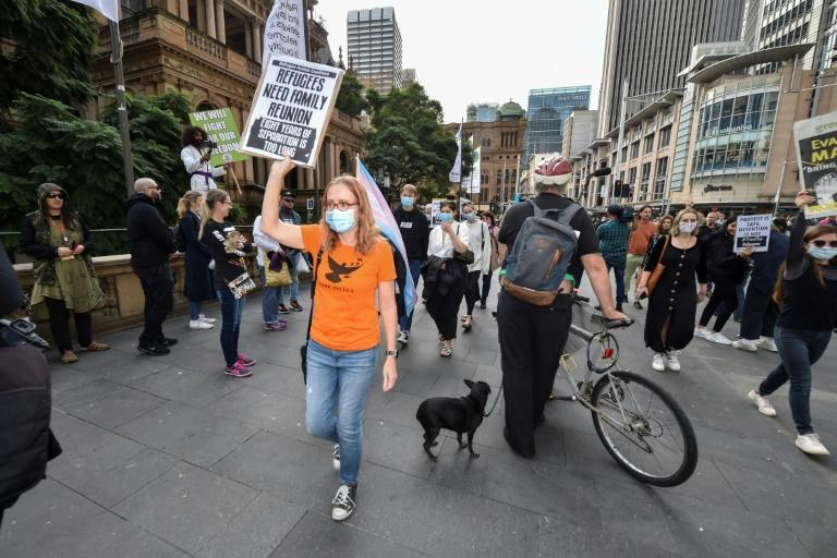 Protesters attend a pro-refugee rights march in Sydney in June