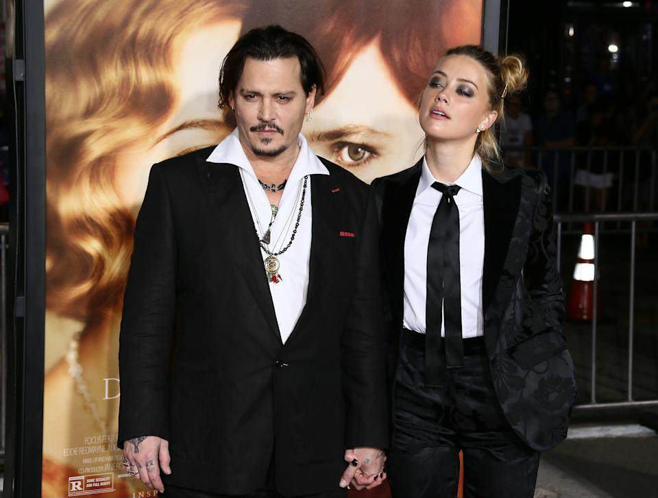 WESTWOOD, CA - NOVEMBER 21: Johnny Depp and Amber Heard attend the premiere of Focus Features' 'The Danish Girl' at Westwood Village Theatre on November 21, 2015 in Westwood, California.