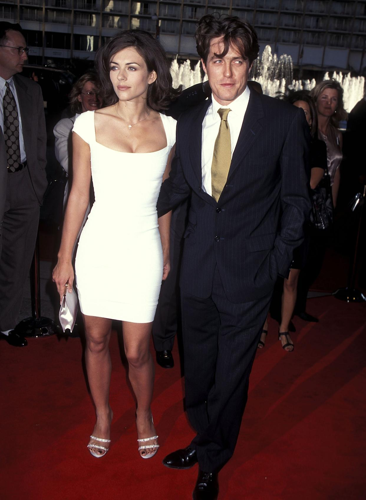 """Elizabeth Hurley and actor Hugh Grant attend the """"Nine Months"""" Century City Premiere on July 11, 1995 at Cineplex Odeon Century Plaza Cinemas in Century City, California. (Photo by Ron Galella, Ltd./Ron Galella Collection via Getty Images)"""