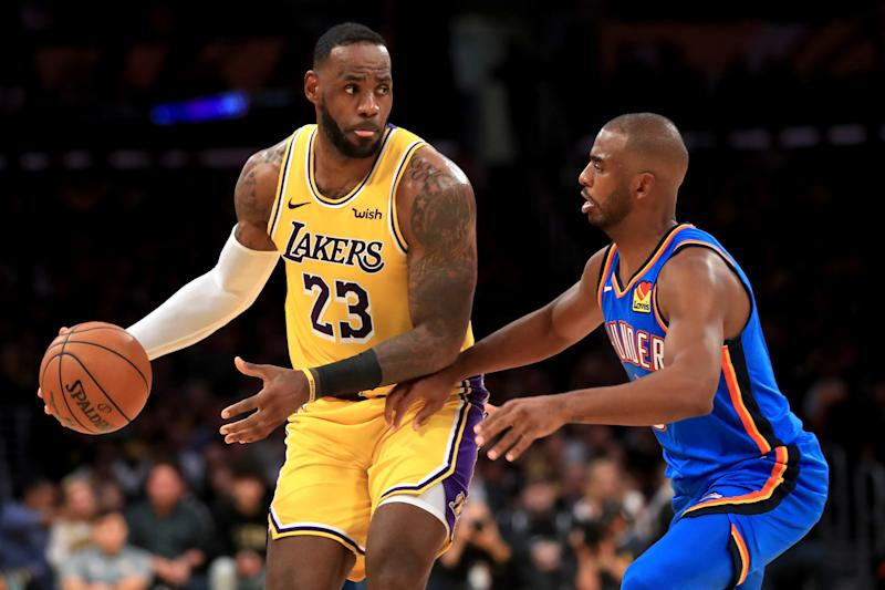 Old friends LeBron James and Chris Paul meet again with their latest set of weapons around them. (Sean M. Haffey/Getty Images)