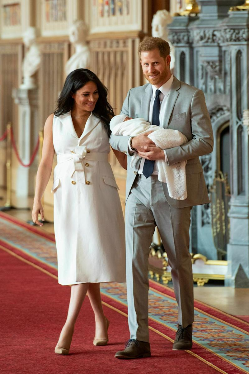 "Britain's Prince Harry and Meghan, Duchess of Sussex, arrive for a photocall with their newborn son, in St George's Hall at Windsor Castle, Windsor, south England, Wednesday May 8, 2019. Baby Sussex was born Monday at 5:26 a.m. (0426 GMT; 12:26 a.m. EDT) at an as-yet-undisclosed location. An overjoyed Harry said he and Meghan are ""thinking"" about names. (Dominic Lipinski/Pool via AP)"