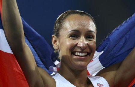 Silver medal winner Jessica Ennis-Hill (GBR) of Britain celebrates after the event. REUTERS/Ivan Alvarado