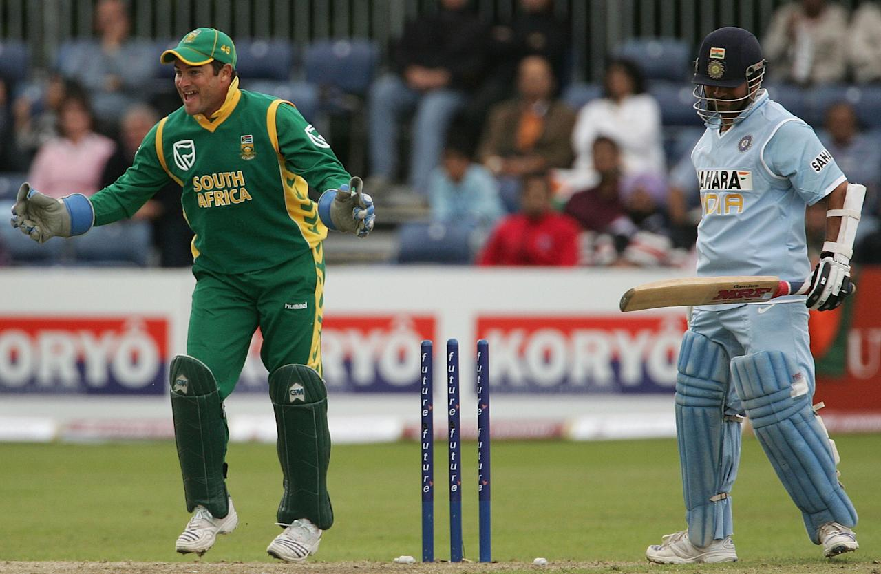 BELFAST, UNITED KINGDOM - JUNE 29:  Mark Boucher of South Africa celebrates after Sachin Tendulkar of India was bowled by Thandi Tshabalala of South Africa during the second One Day International match between South Africa and India at the Civil Service Cricket Club in Stormont on June 29, 2007 in Belfast, Northern Ireland.  (Photo by Hamish Blair/Getty Images)