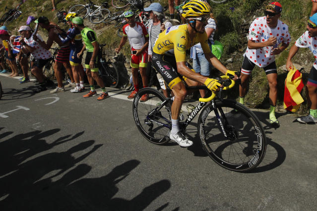 France's Julian Alaphilippe wearing the overall leader's yellow jersey climbs the Tourmalet pass during the fourteenth stage of the Tour de France cycling race over 117.5 kilometers (73 miles) with start in Tarbes and finish at the Tourmalet pass, France, Saturday, July 20, 2019. (AP Photo/ Christophe Ena)