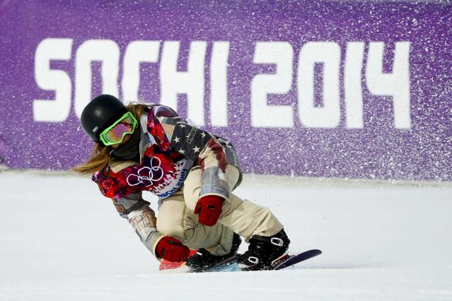 Winner Jamie Anderson of the U.S. competes during the women's snowboard slopestyle finals event at the 2014 Sochi Winter Olympics in Rosa Khutor, February 9, 2014. REUTERS/Mike Blake (RUSSIA - Tags: SPORT OLYMPICS SPORT SNOWBOARDING TPX IMAGES OF THE DAY)