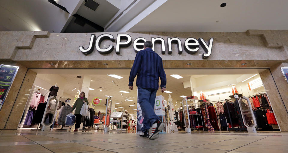 In this Nov. 24, 2017, file photo, a shopper heads into a J.C. Penney store in Seattle J.C. Penney Co. (AP Photo/Elaine Thompson, File)