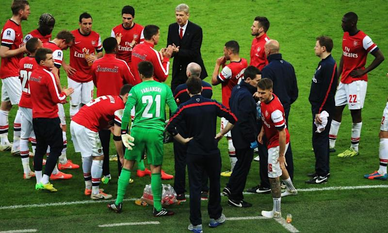 Arsène Wenger gives a team talk before the 2014 semi-final shootout with Wigan Athletic. The match finished 1-1 and Arsenal won the shootout 4-2.