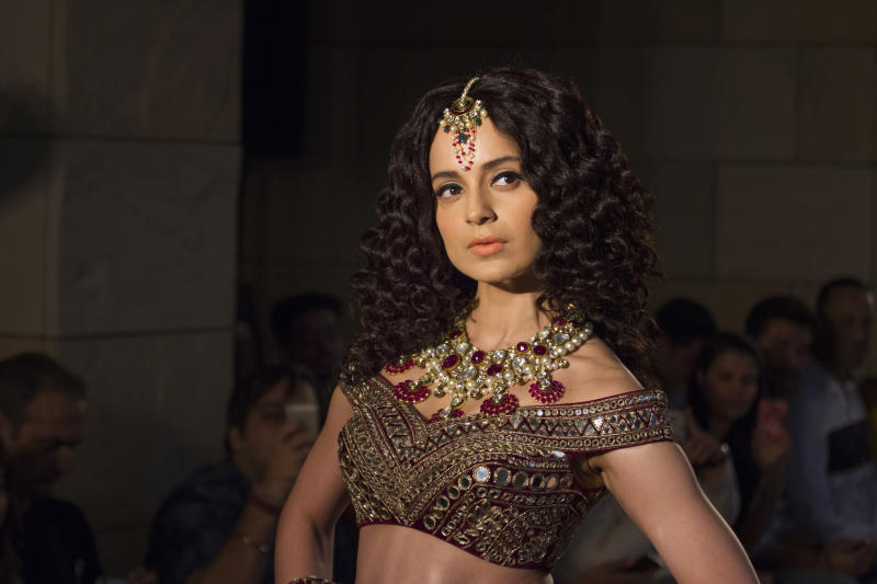 Bollywood actress Kangana Ranaut displays a creation by Indian designer Manav Gangwani at the India Couture Week 2016, in New Delhi, India, Sunday, July 24, 2016. (AP Photo/Thomas Cytrynowicz)
