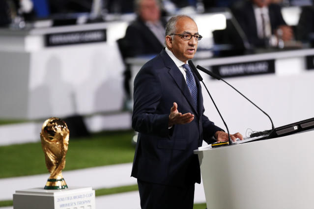 President of U.S. Soccer Carlos Cordeiro presents a joint United bid by Canada, Mexico and the United States to host the 2026 World Cup at the FIFA congress in Moscow, Russia, Wednesday, June 13, 2018. (AP Photo/Pavel Golovkin)