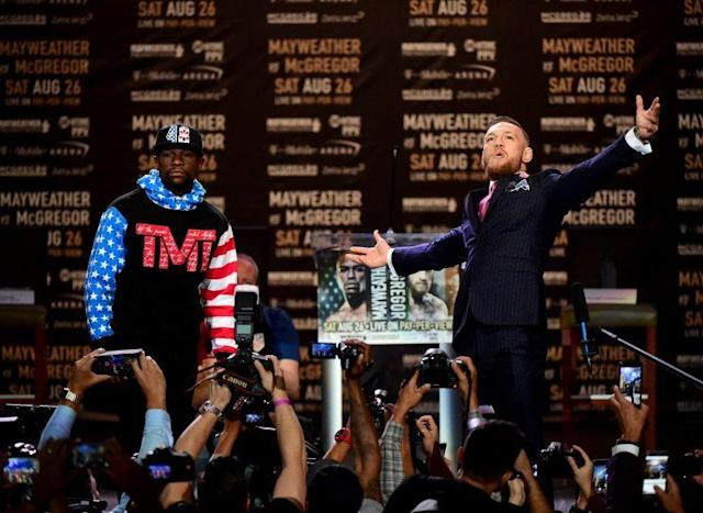 Conor McGregor and Floyd Mayweather share the stage for the first time. (Getty)